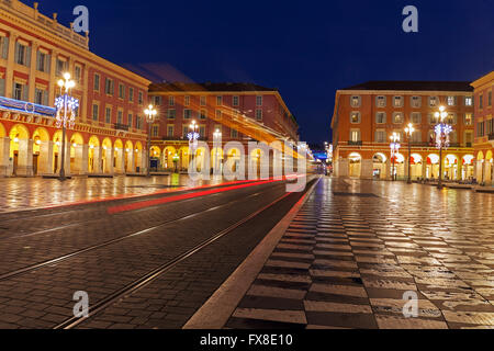 Nice, Place Massena,- Showing the square with tram lines and chequered  paving, early morning, France - Stock Photo