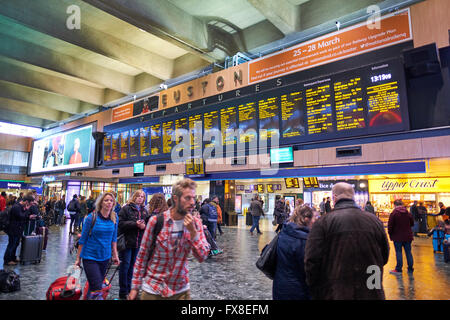 Electronic Departure Board Euston Train Station London UK - Stock Photo
