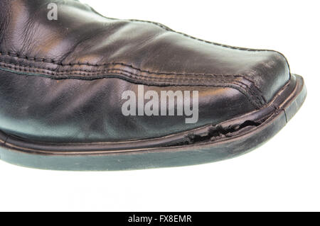 Broken black shoe isotaled on a white background - Stock Photo