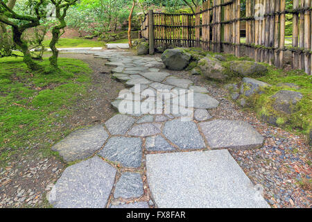 Stone Path Walkway With Bamboo Fence At Japanese Garden   Stock Photo
