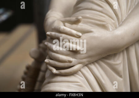 Poetess Sappho, 1852. Marble statue by James Pradier (1790-1852). Detail hands. Orsay Museum. Paris. France. - Stock Photo