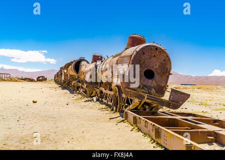 The abandoned rusty old train at Uyuni desert in Bolivia - Stock Photo