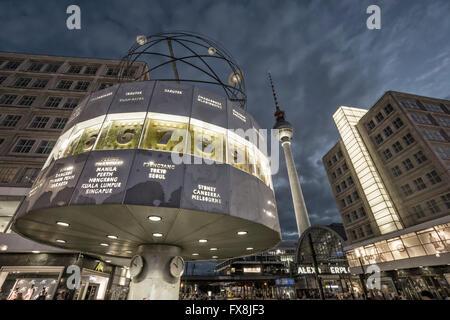 berlin alexander square, world  clock, tv tower alex, tram in background,twilight - Stock Photo
