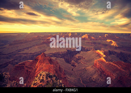 Vintage toned sunset over Grand Canyon, one of the top tourist destinations in the United States. - Stock Photo