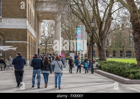 People making their way into the Rolling Stone exhibition at the Saatchi Gallery in Kings Road, Chelsea, London. - Stock Photo