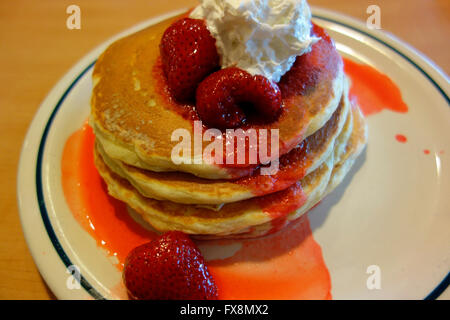 a stack of pancakes with strawberries - Stock Photo