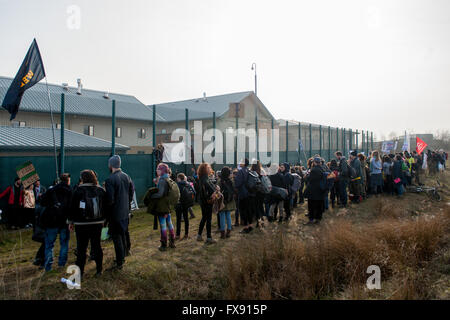 As the migrant and refugee crisis continues, over a thousand protesters gather behind Yarl's Wood Immigration Removal - Stock Photo