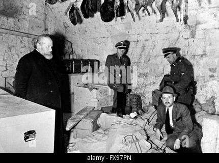 The Nazi propaganda image depicts member of the German Gestapo with a part of the Serbian treasury in the Ostrog - Stock Photo