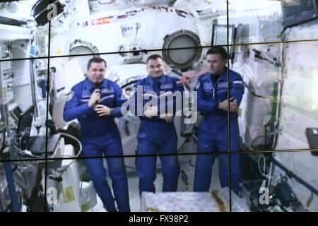 Moscow, Russia. 12th Apr, 2016. Russian cosmonauts (from L to R) Yuri Malenchenko, Alexei Ovchinin and Oleg Skripochka - Stock Photo