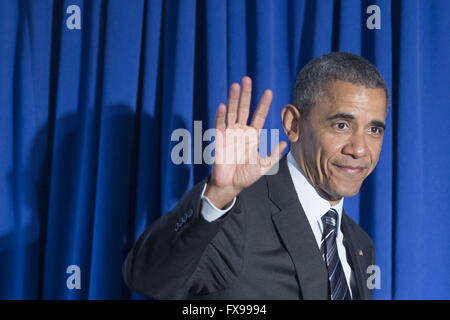 Washington DC, USA. 12th April, 2016. US President Barack Obama waves as he enters to deliver remarks at the newly - Stock Photo