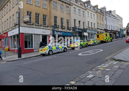 Bristol, UK. 12th April 2016. Police and ambulance services attend an incident which left a car on the pavement outside the Boston Tea Party cafe on Park Street, one of the main roads in the city's West End. Credit:  Keith Ramsey/Alamy Live News