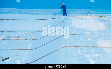 Hanover, Germany. 11th Apr, 2016. Helfer Wolfgang Wagener paints the swimming pool with blue paint at the Annabad - Stock Photo