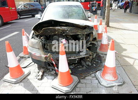 Burned out car on roadside is Islington, London - Stock Photo