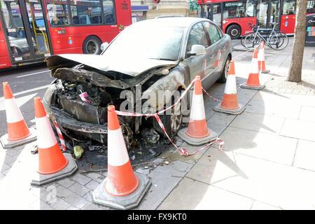 Burned out car on roadside is Islington, London - Stock Photo
