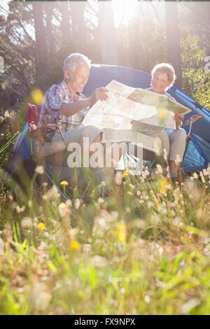 Senior couple studying the map - Stock Photo