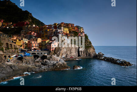 Manarola, part of the Cinque Terre on Italy's north west coast, early April 2016, showing colorful houses and the - Stock Photo