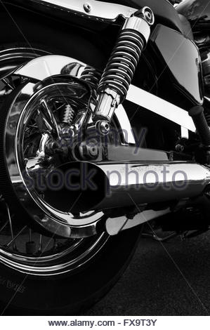 Black and white close-up of the side rear of a Harley Davidson with Screamin' Eagle II exhaust pipe - Stock Photo