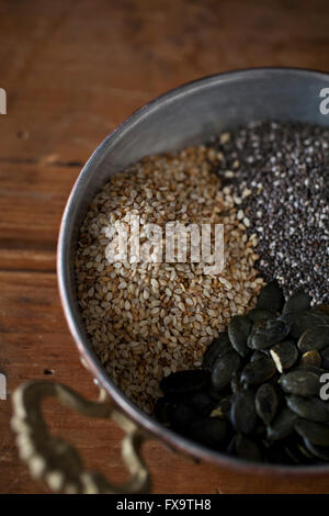 Sesame, chia and pumpkin seeds in a bowl - Stock Photo