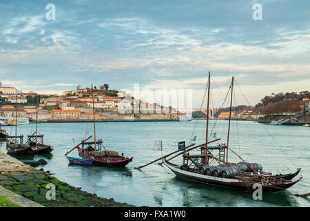 Traditional boats on Douro river at sunrise, Porto, Portugal. - Stock Photo