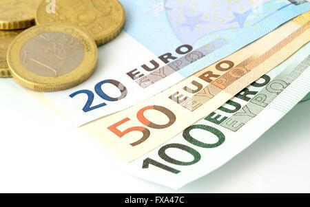 European Union banknotes and coins on white background. Euro currency. Euro coins. Euro banknote. 100 Euro. 50 Euro. - Stock Photo