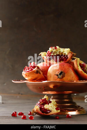 Organic ripe red fruit pomegranate, whole and broken - Stock Photo