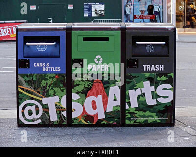 RECYCLING. 3 trash bins in Times Square, one for paper, one for cans and bottles and one for regular trash. - Stock Photo