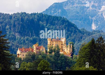 19th century Schloss Hohenschwangau Castle in Bavarian Alps near Schwangau, Allgaeu, Fussen, Bavaria, Germany, Europe. - Stock Photo