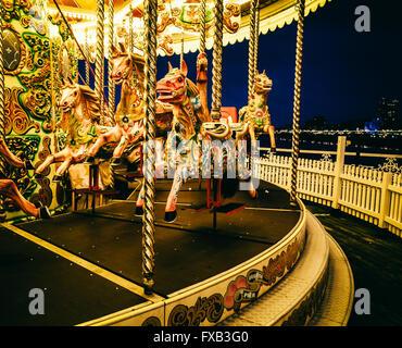 Merry-go-round on Brighton Pier at night, UK - Stock Photo