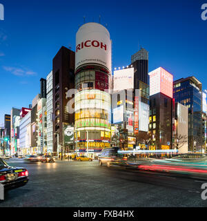 Tokyo, Japan - January 18, 2015: Ginza shopping district at rush hour in Tokyo. The iconic Sanaa Building is at - Stock Photo