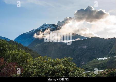 Eruption of a volcano Tungurahua, Cordillera Occidental of the Andes of central Ecuador, South America - Stock Photo