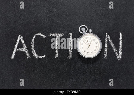 action word handwritten on chalkboard with vintage precise stopwatch used instead of O - Stock Photo