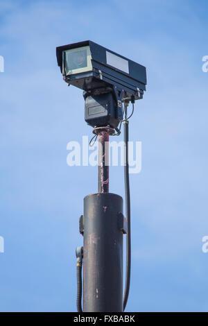 CCTV Camera in Tall Post - Stock Photo