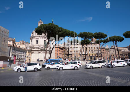 White taxis in a line waiting for fares in Rome, italy - Stock Photo