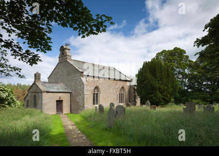 The small 14th Century church of St Wilfred where Lancelot 'Capability' Brown was baptized in 1716, Kirkharle, Northumberland, - Stock Photo