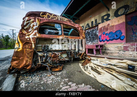 An Old City Bus Is Abandoned In A Junkyard In Frankfort