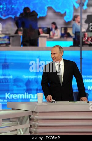 Moscow, Russia. 14th Apr, 2016. Russian President Vladimir Putin attends a televised question-and-answer session - Stock Photo