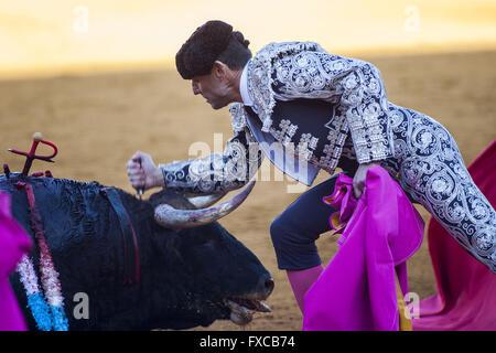 Seville, Spain. 14th Apr, 2016. Bullfighter kills the bull during a bullfight of the ''Feria de Abril'' (April Fair) - Stock Photo