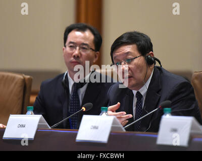 Washington, DC, USA. 14th Apr, 2016. Chinese Minister of Finance Lou Jiwei(R) attends a special meeting of New Development - Stock Photo