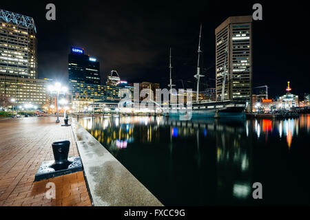 Waterfront promenade and modern buildings at night, at the Inner Harbor, in Baltimore, Maryland. - Stock Photo