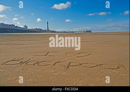 I love Blackpool written on the sand with Blackpool Tower and  North Pier - Stock Photo