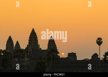 Sun rising over the silhouette of the main temple in Angkor Wat - Siem Reap, Cambodia - Stock Photo