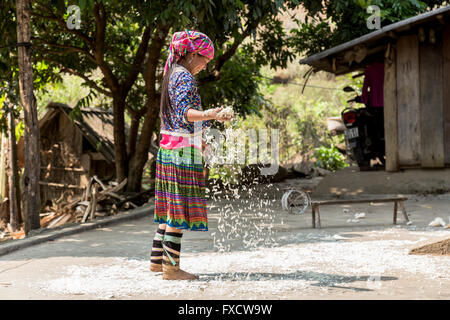SaPa, Vietnam - March 2016. A girl from a minority village working in her house. - Stock Photo