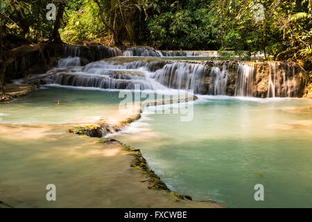 The beautiful Kuang Si Falls in Luang Prabang, Laos - Stock Photo