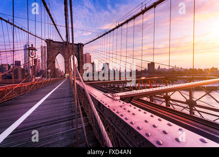 New York City, USA, early in the morning on the famous Brooklyn Bridge - Stock Photo