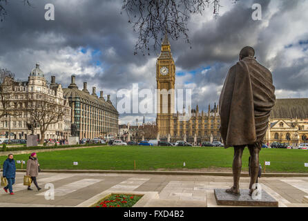 The bronze statue of Mahatma Gandhi,  Parliament Square London - Stock Photo