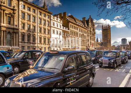 London Taxi Drivers Association Protest against Uber in London, hundred of Black London Taxis blockade Whitehall - Stock Photo