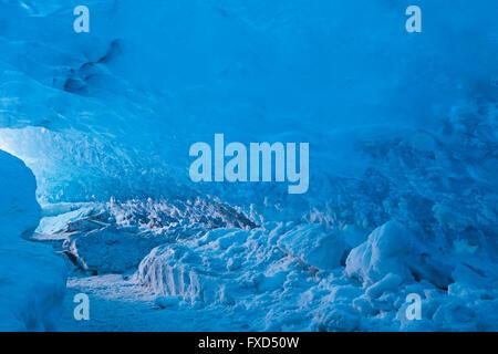 Blue ice in ice cavern inside Breidamerkurjokull, outlet glacier of Vatnajökull / Vatna Glacier on Iceland - Stock Photo