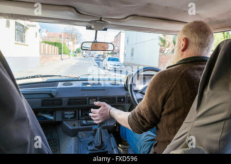 Car driving: Man changing gear while driving a Range Rover, Nottinghamshire, England, UK - Stock Photo