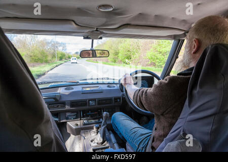 Man driving a Range Rover on a road, Nottinghamshire, England, UK - Stock Photo