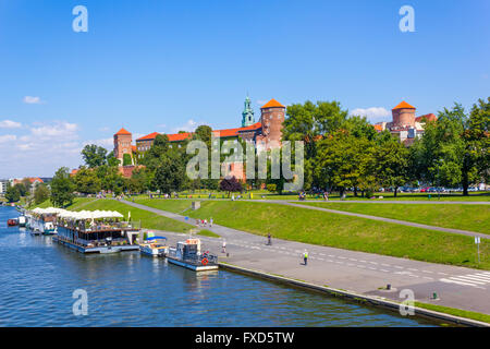 Boats and Wawel Castle at the Wisla River in Krakow, Poland - Stock Photo